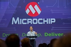 Microchip President Steve Sanghi standing in front of 80 foot screen at Masters Conference